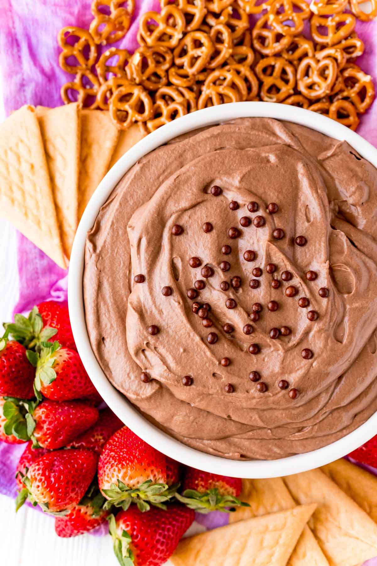 White bowl with brownie batter dip and dippers around it