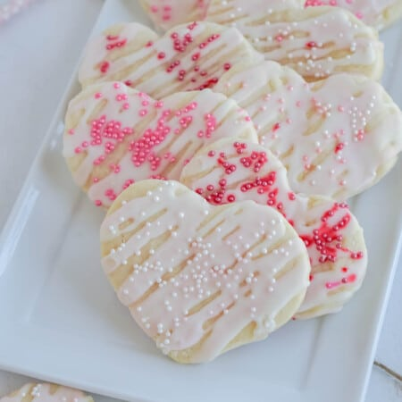 White plate with cream cheese sugar cookies
