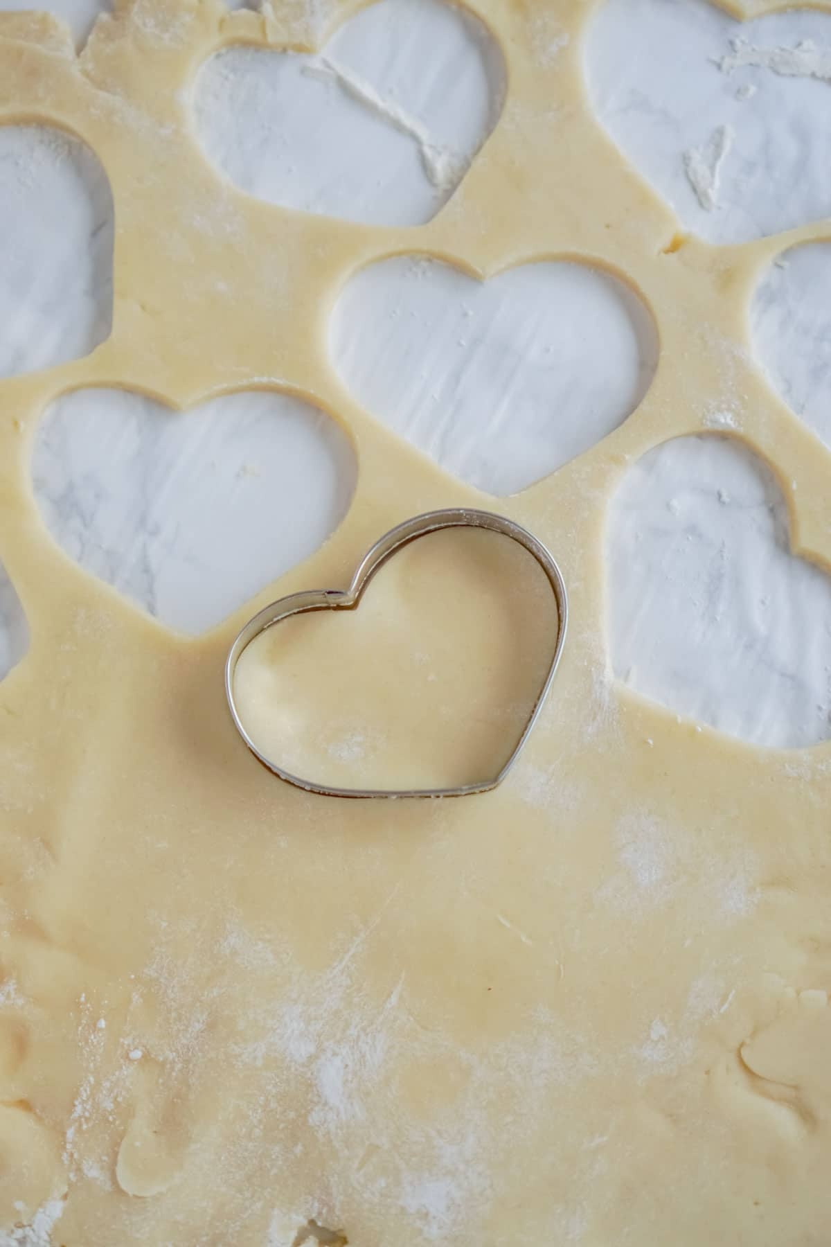 Heart shaped cookie cutter with cookie dough