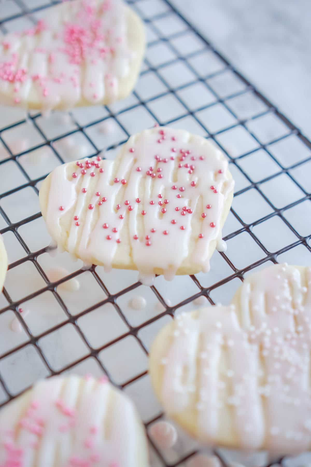 Heart shaped cream cheese sugar cookies decorated with sprinkles