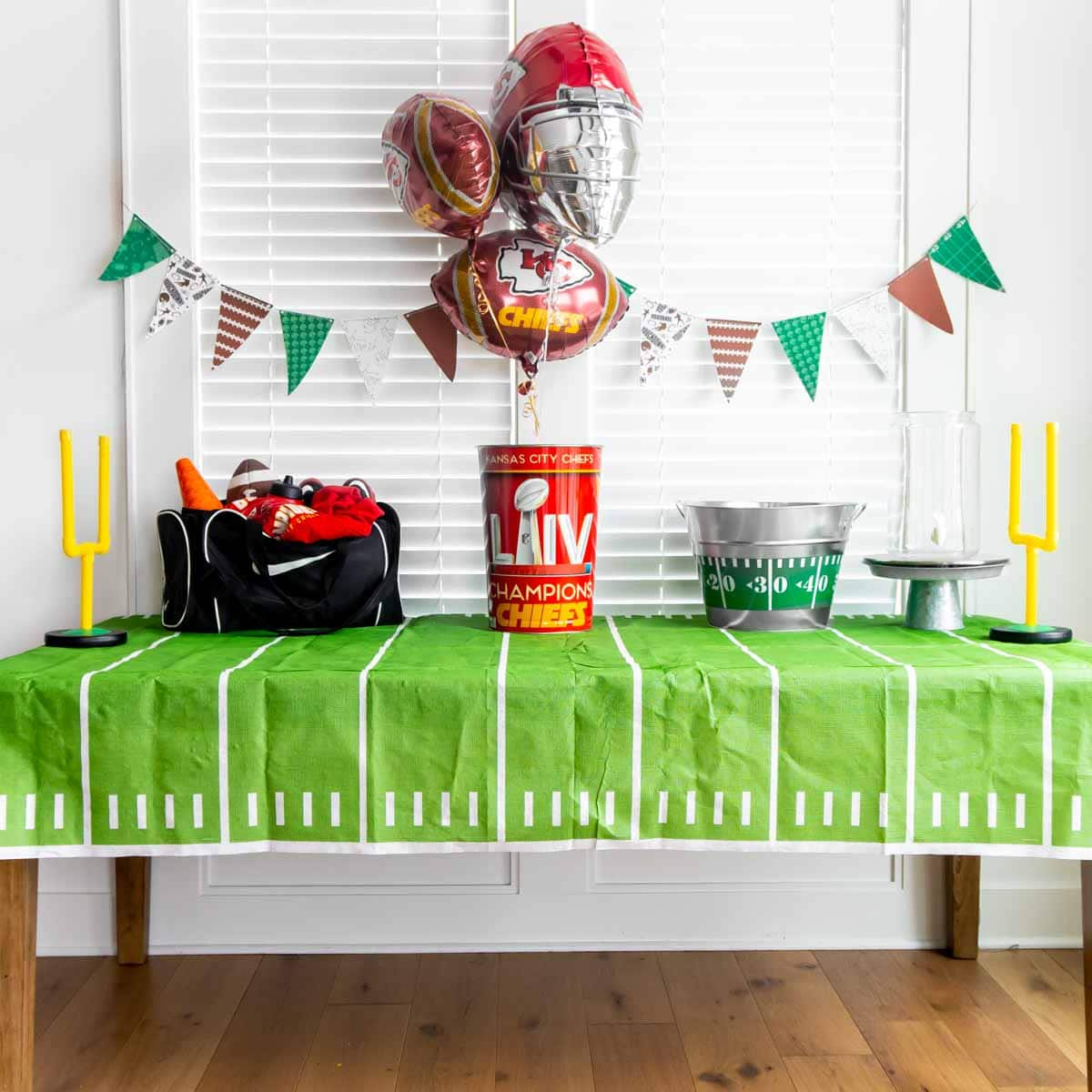 Football party table with large items on it