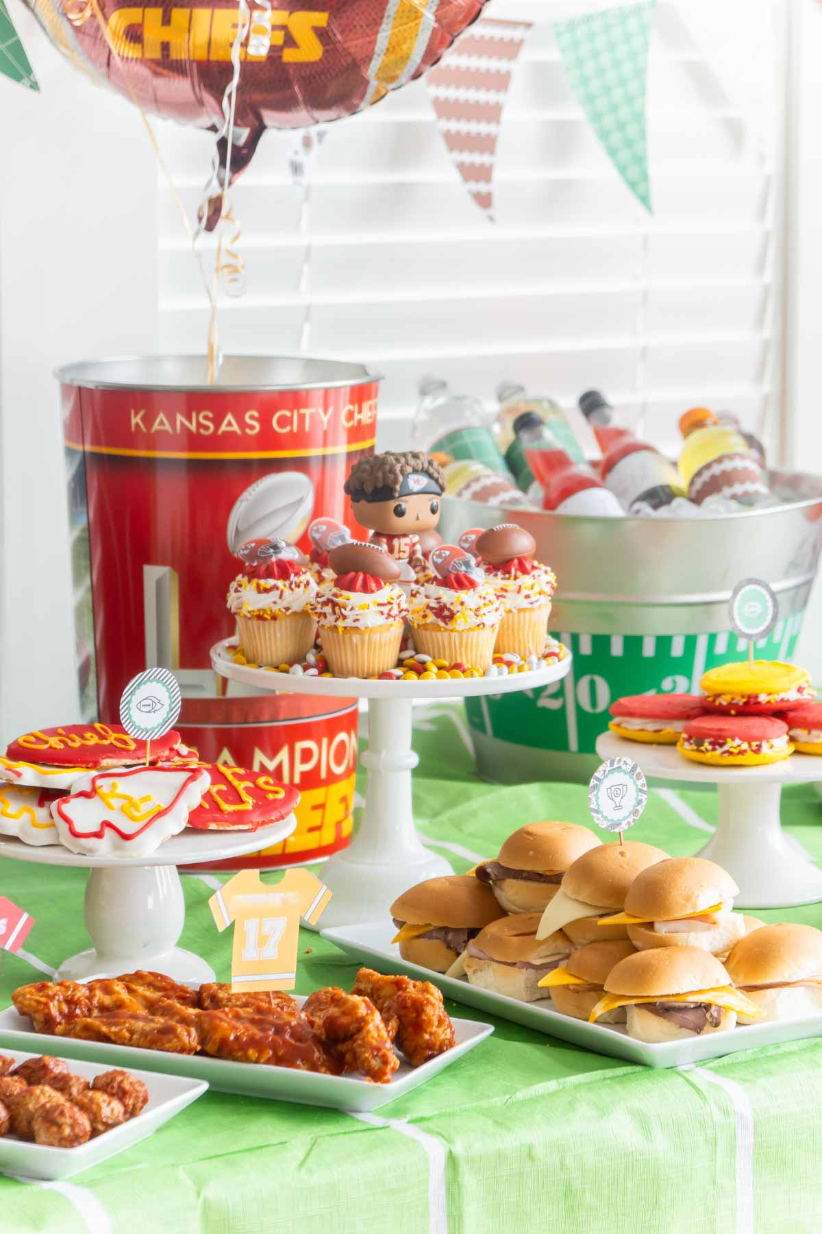 Super Bowl table with Chiefs decorations and food