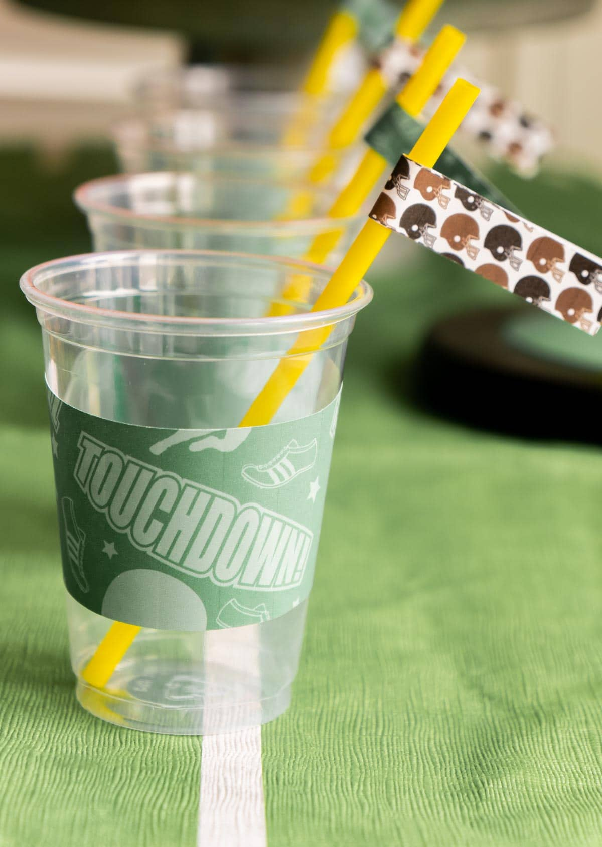 Cups with football printables on them