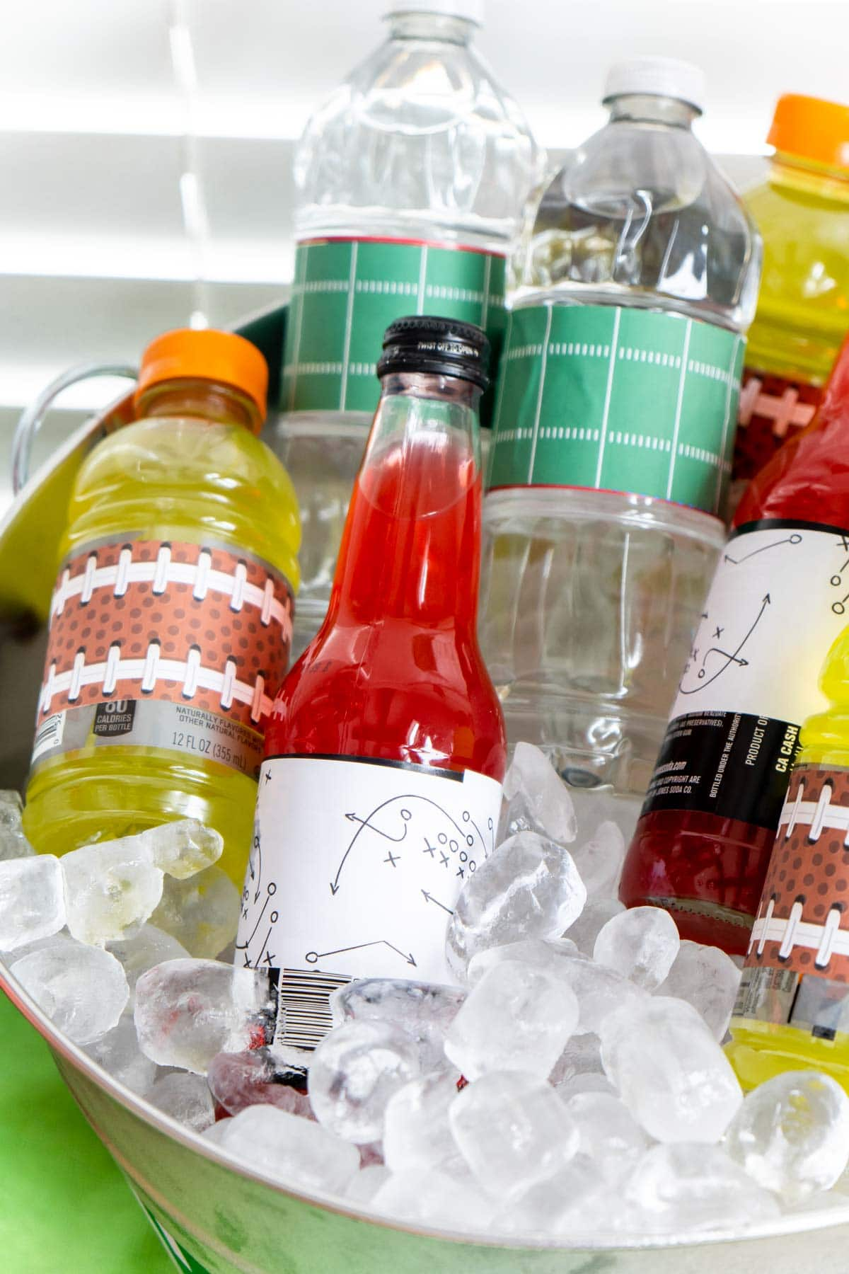 Ice bucket with drinks wrapped in football printables