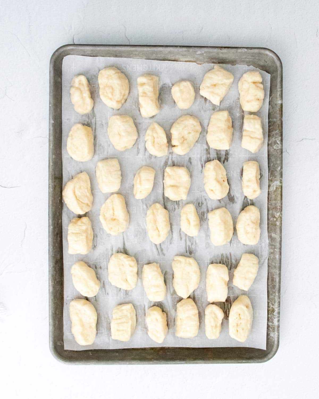 Baking tray full of unbaked pretzel bites