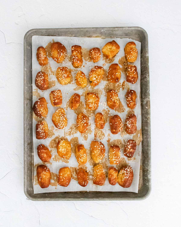 Baking tray full of cooked pretzel bites