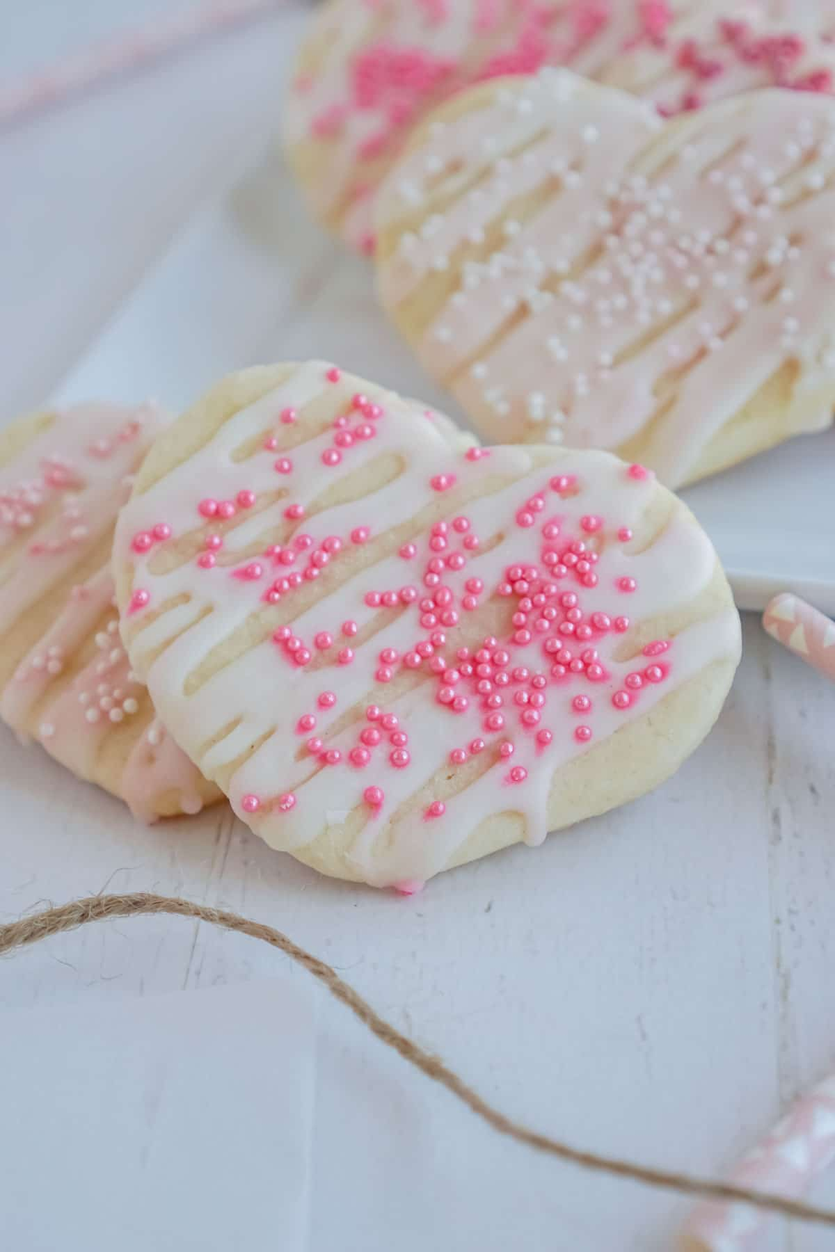 heart shaped cookies with sugar cookie icing and sprinkles