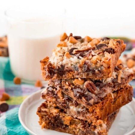 7 layer bars stacked on a white plate