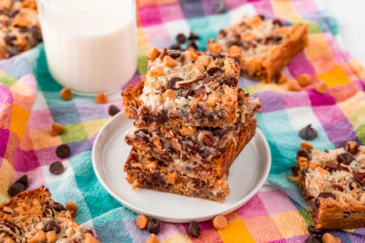 Horizontal photo of 7 layer bars stacked on a plate