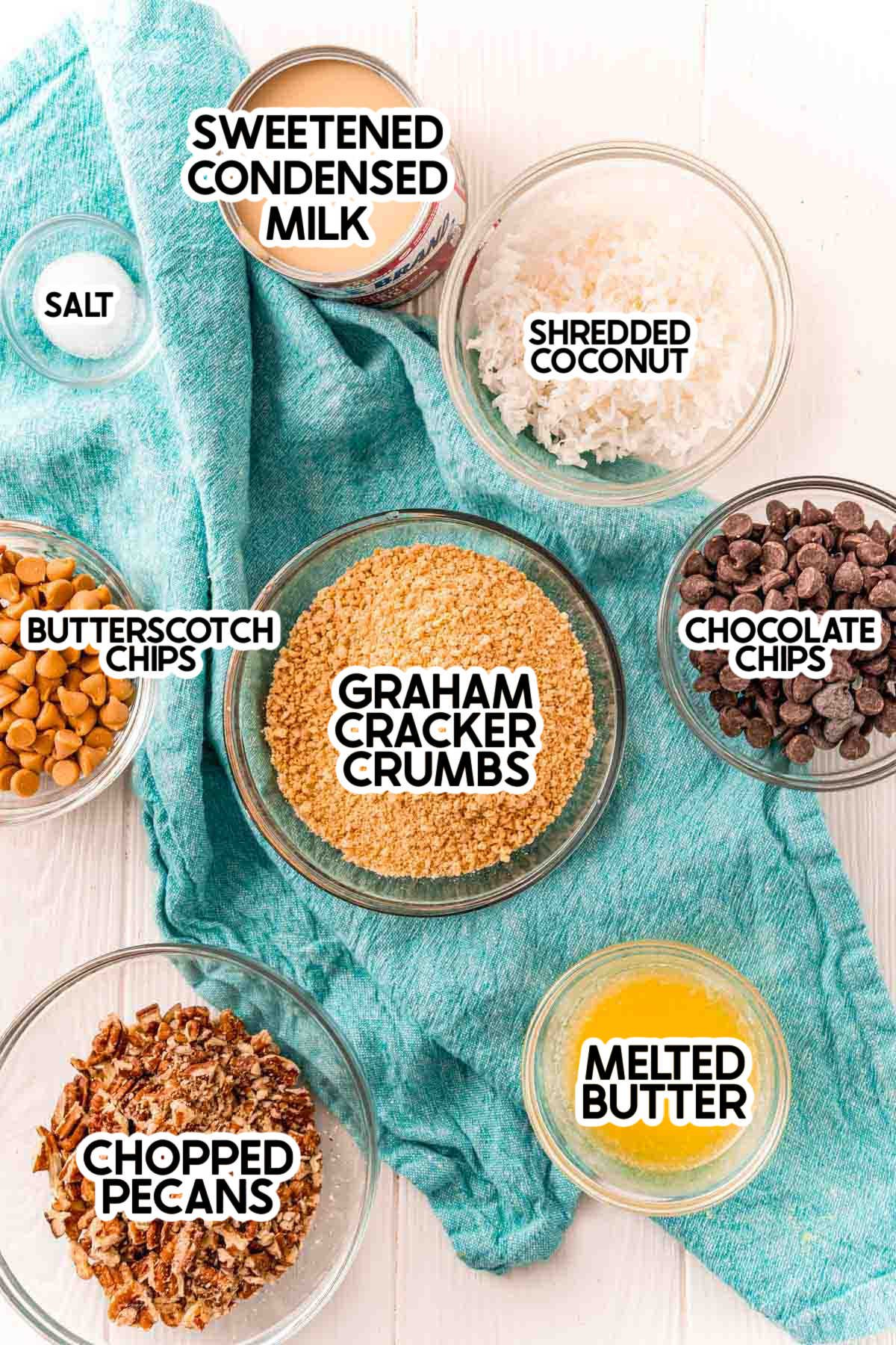 Ingredients needed to make seven layer bars with labels