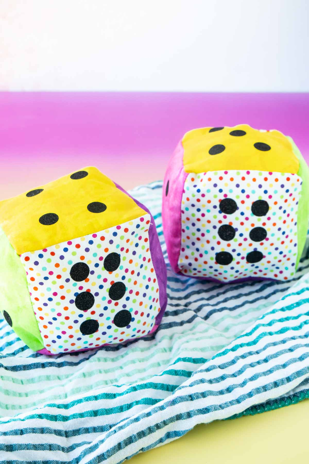 Two colorful DIY dice made out of fabric