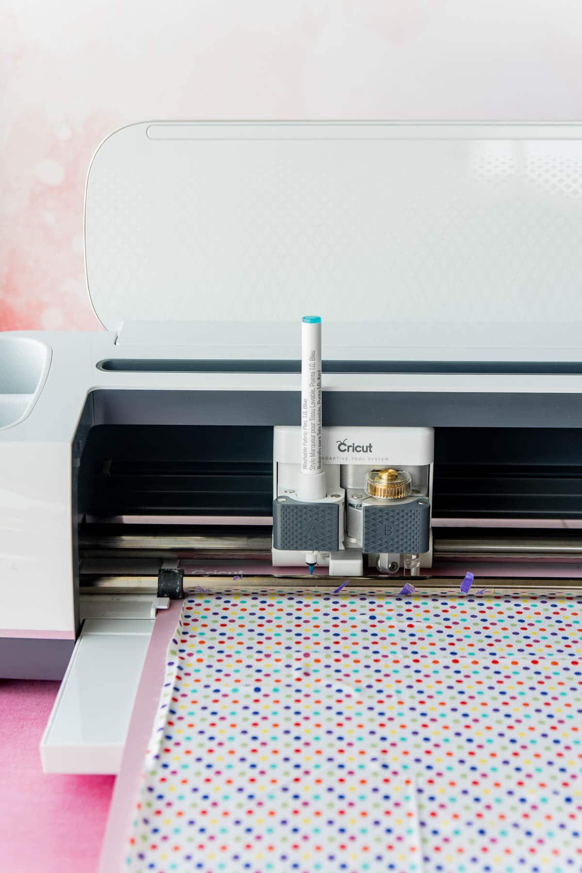 Cricut Maker cutting polka dot fabric