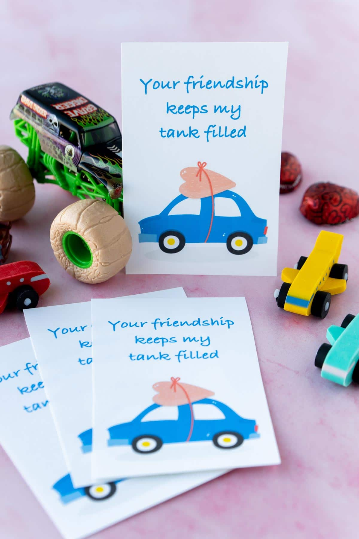 Printed out car valentine with toy cars around