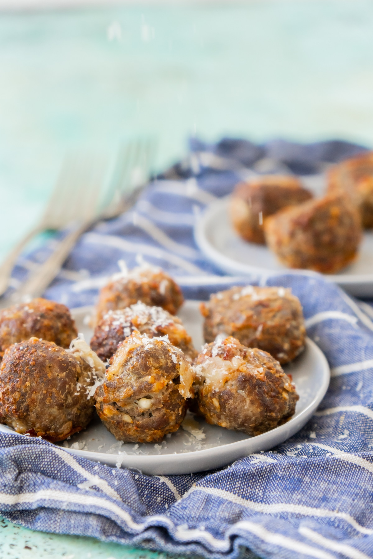 cheese stuffed meatballs on a white plate