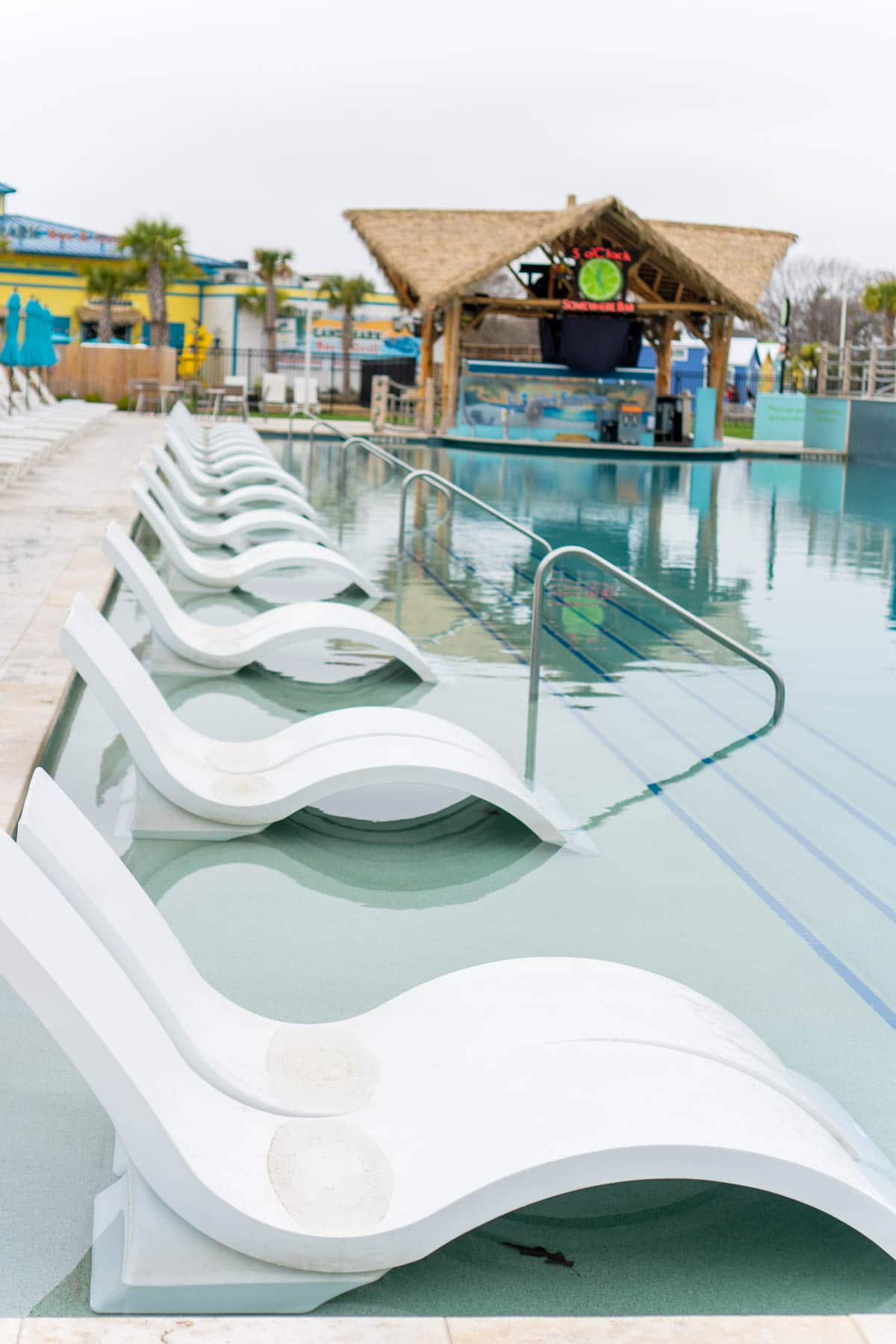 Chairs by a pool at Margaritaville Lake Conroe