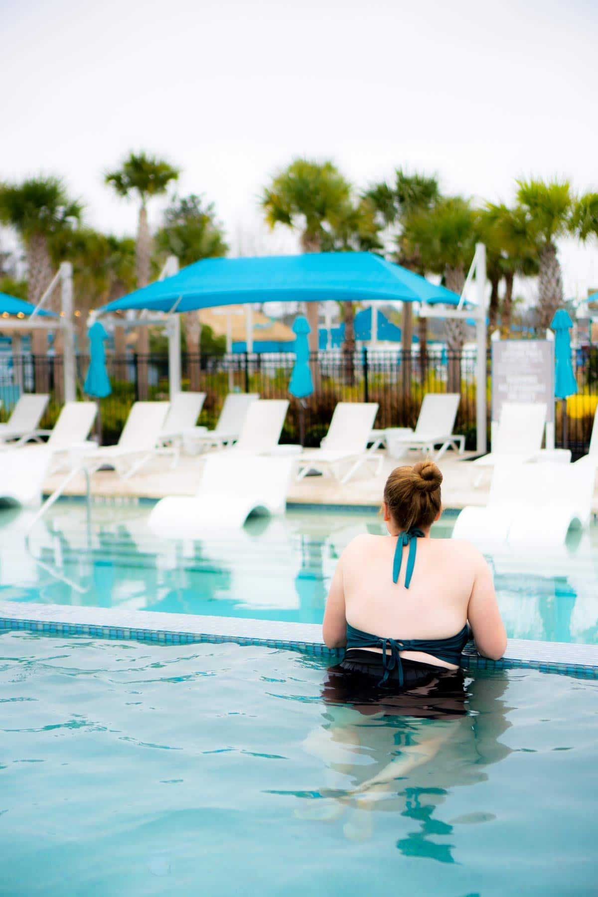 Woman standing in a pool at Margaritaville Conroe