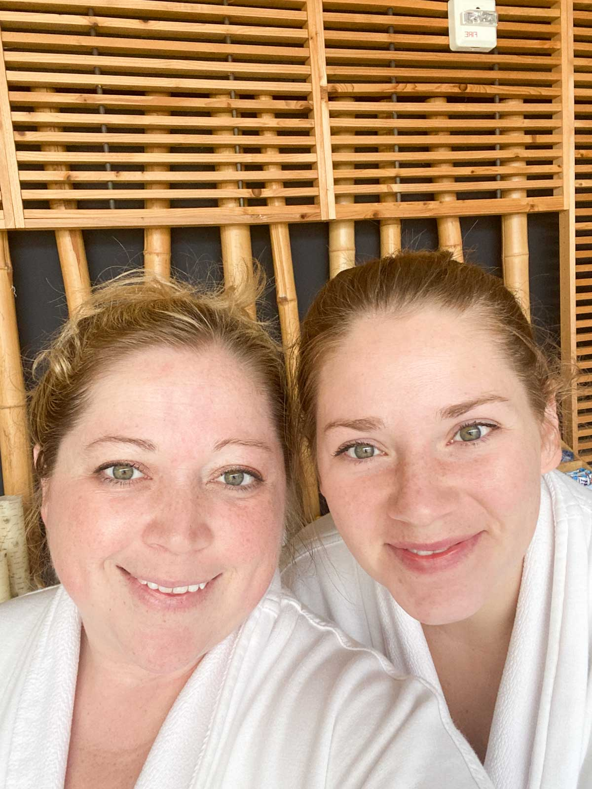 Selfie of two women in robes at a spa
