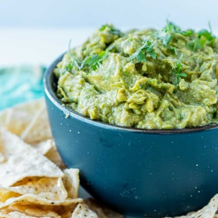 A blue bowl with guacamole in it