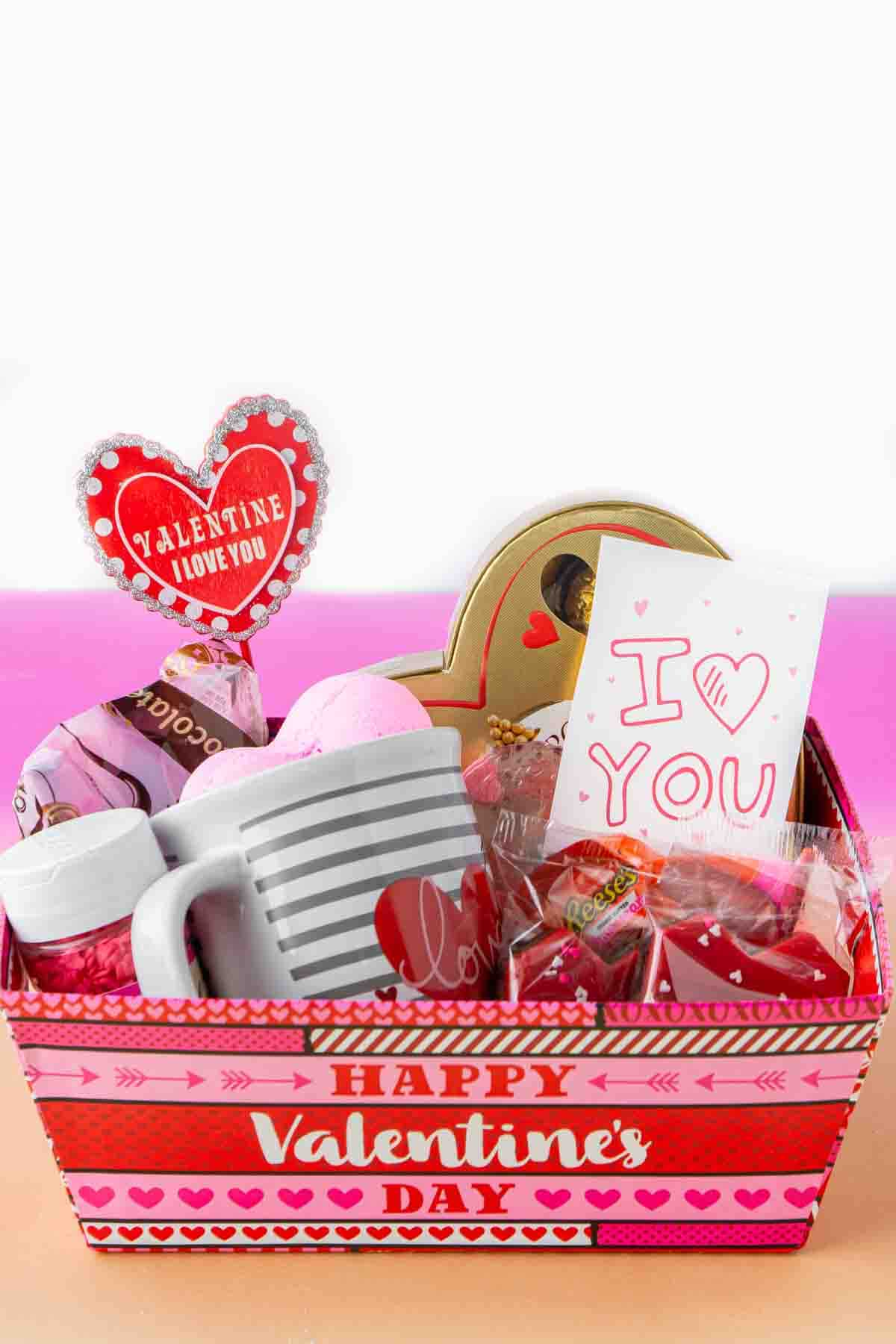Valentines Day basket with candy and gifts inside