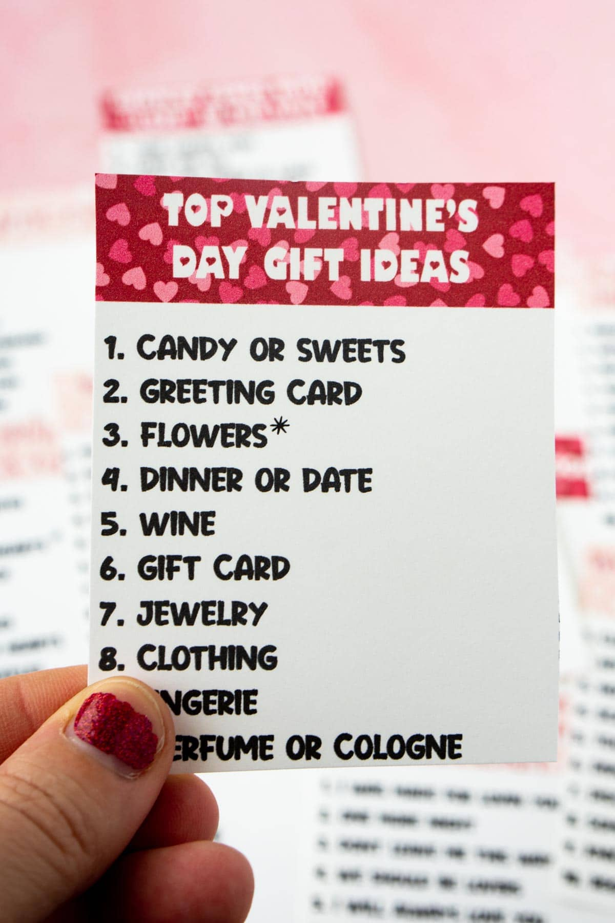 woman's hand holding a Valentines day outburst card