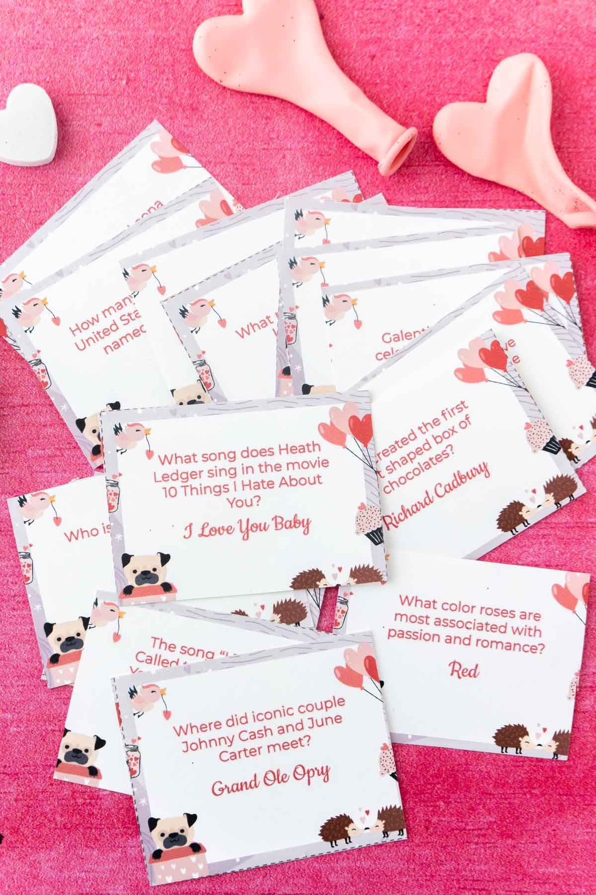 Valentines trivia cards in a pile