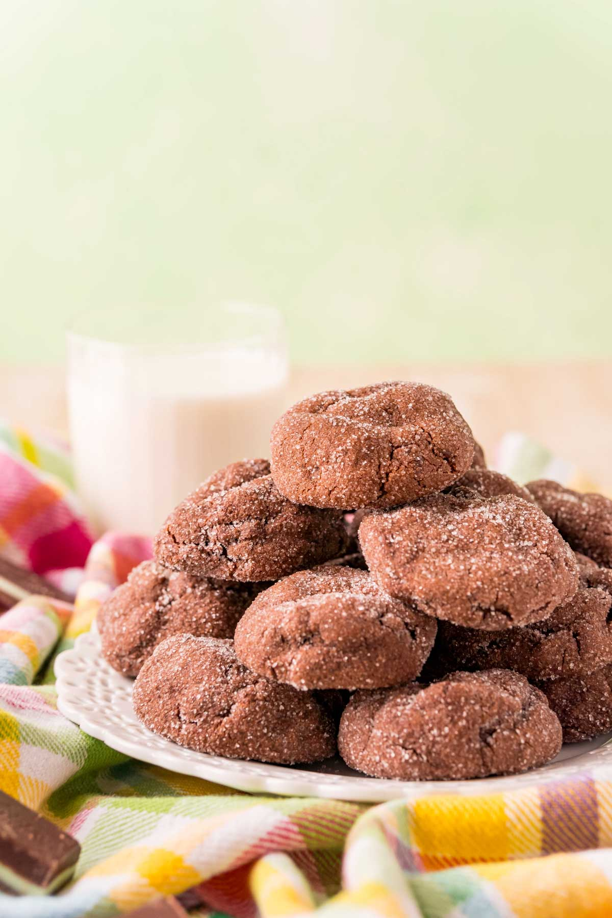 Plate of Andes mint cookies with a glass of milk in the background