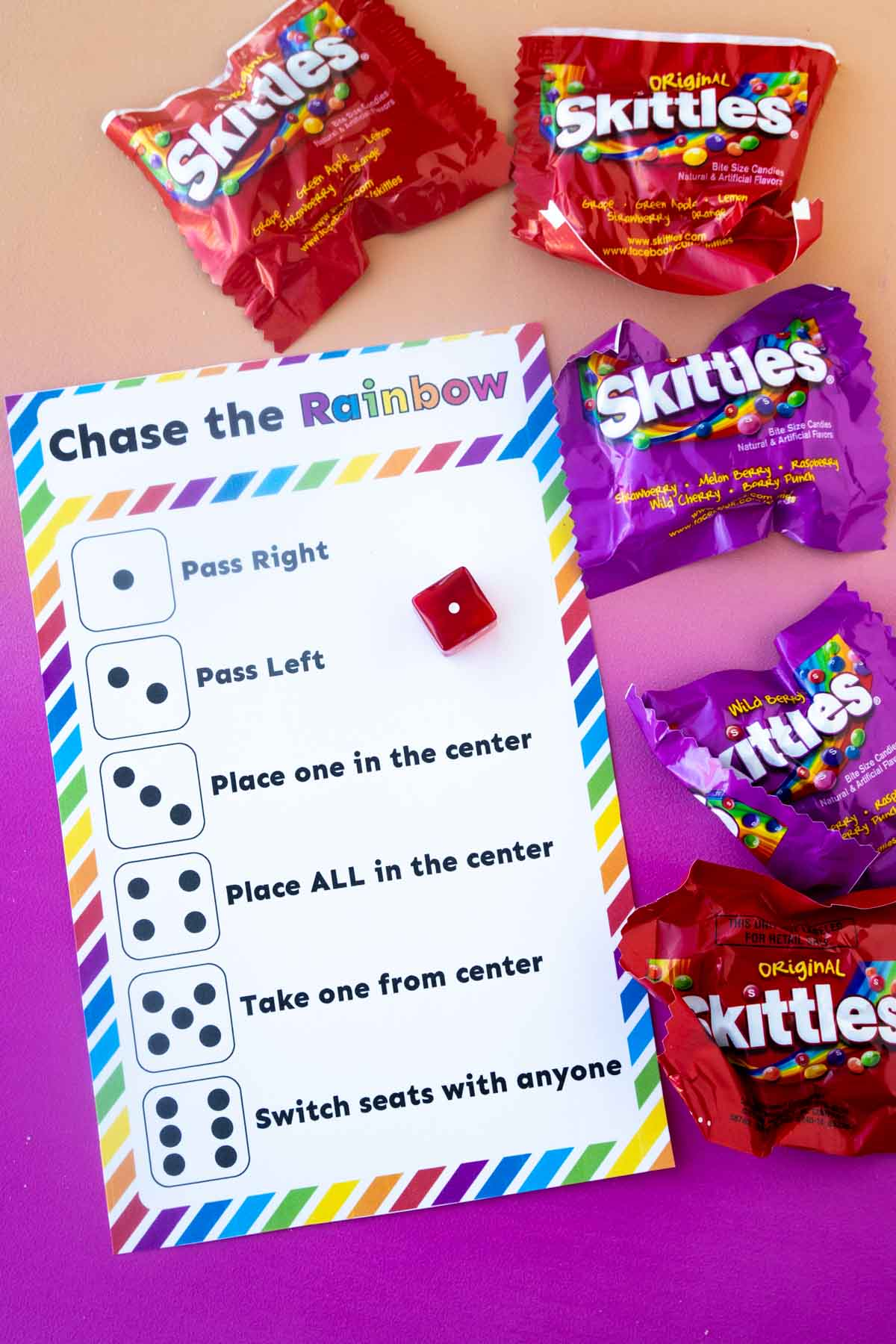 dice skittles game card and bags of skittles