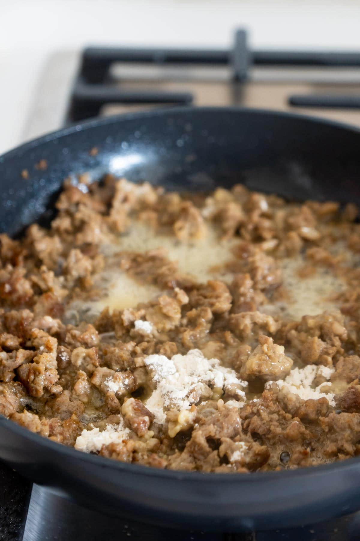 breakfast sausage in a pan with flour