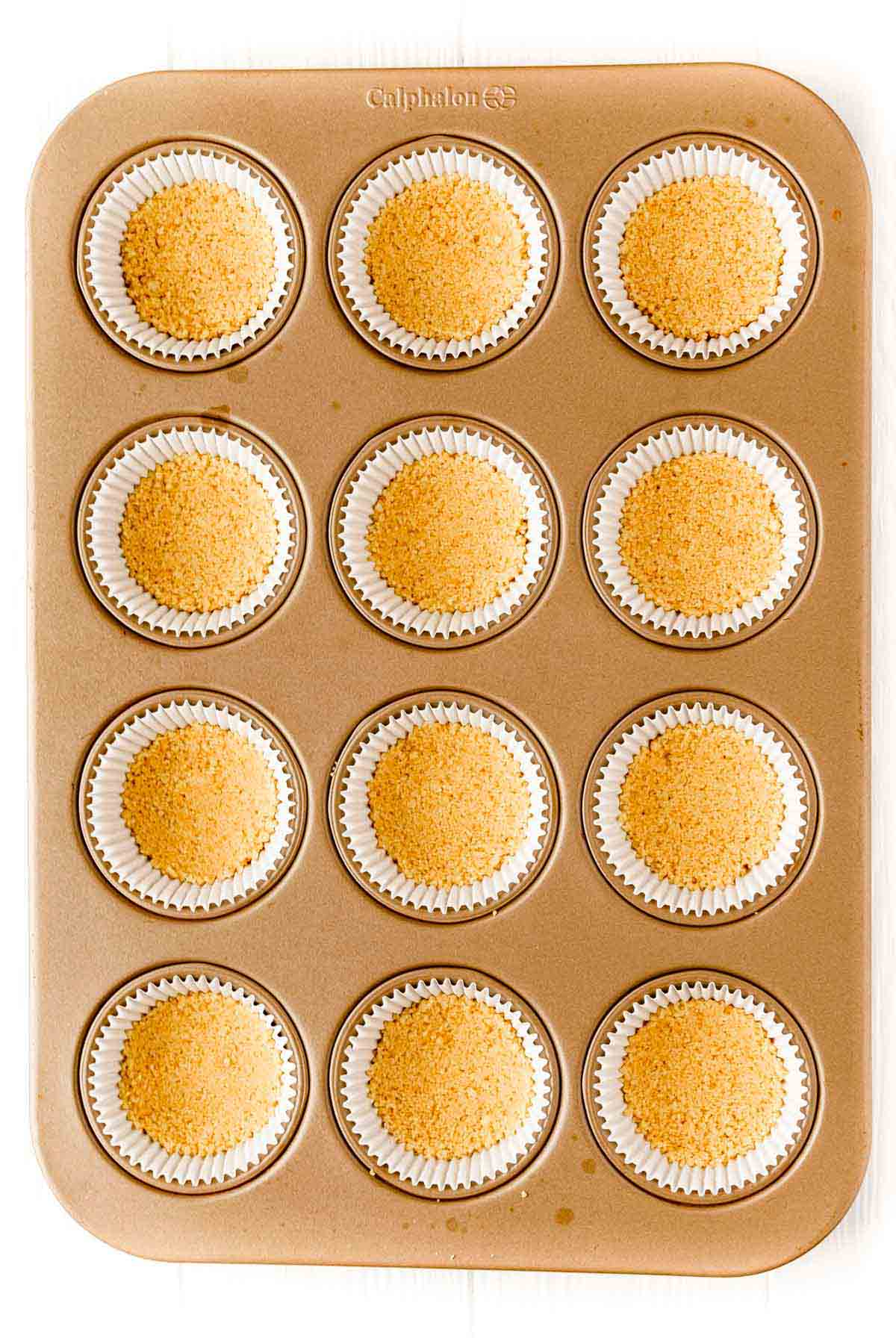 shortbread crust for mini egg cheesecakes in a muffin tin