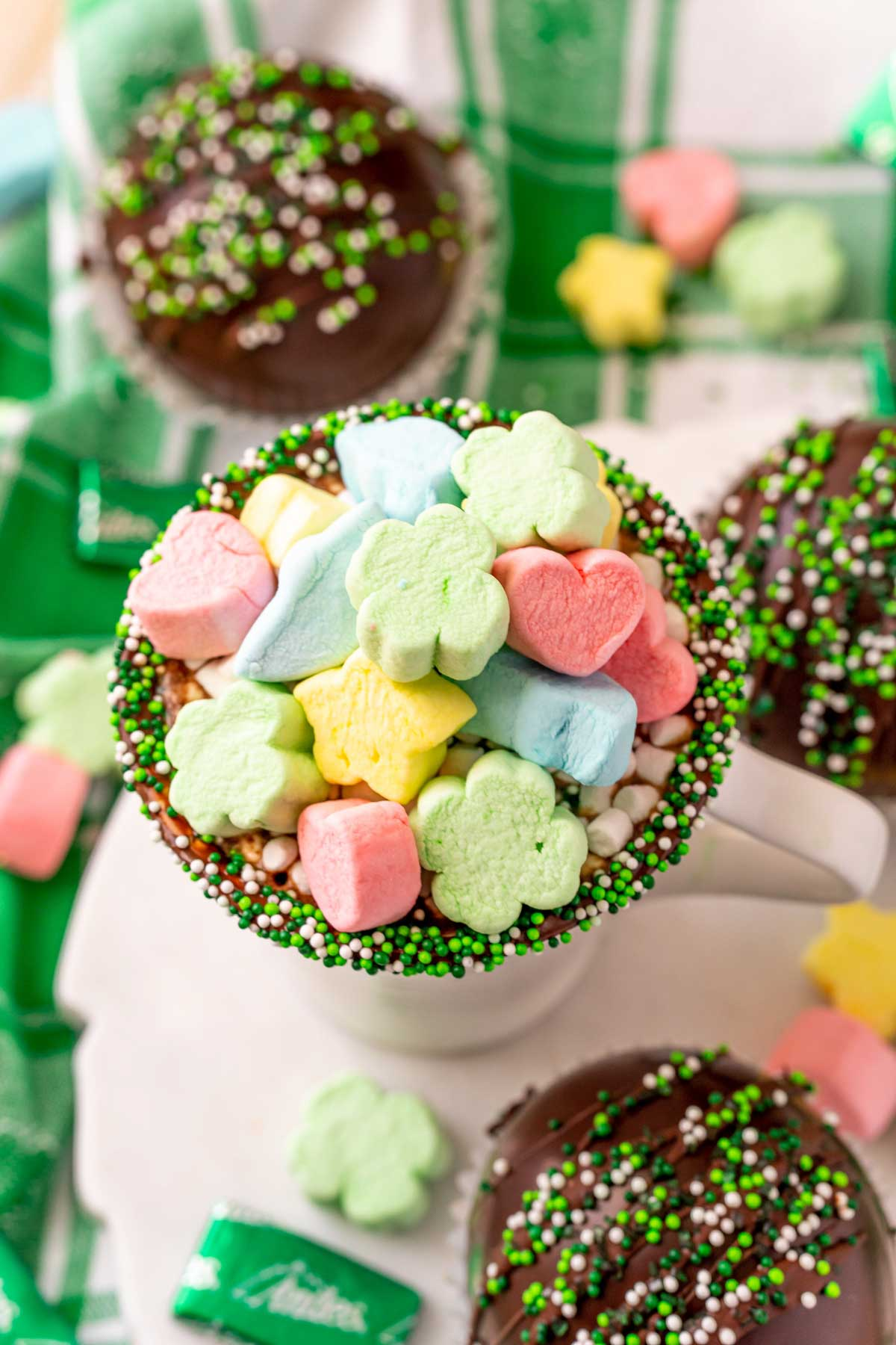Mug filled with hot chocolate and Lucky Charms marshmallows