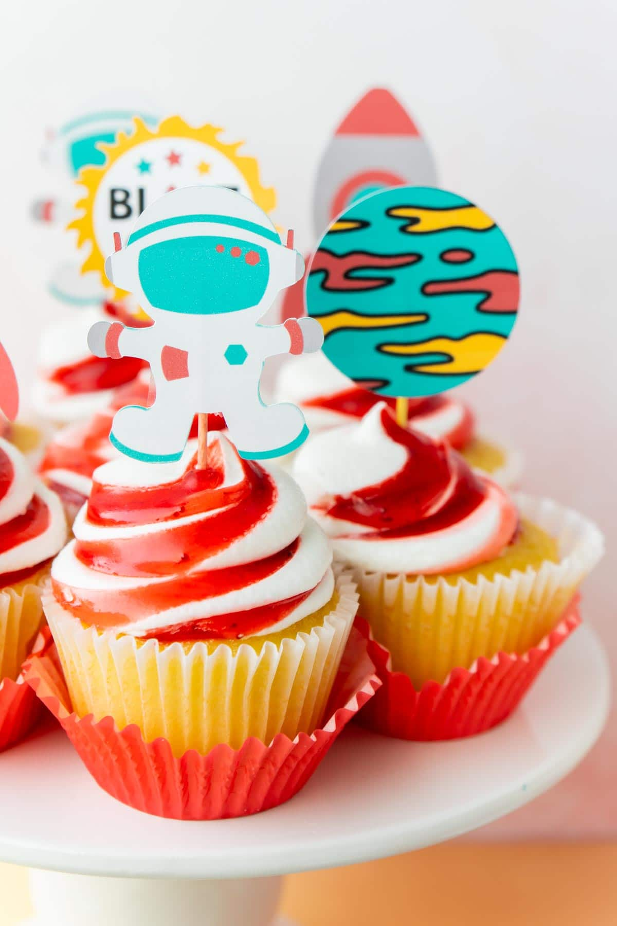 Cupcakes with red frosting and outer space cupcake toppers