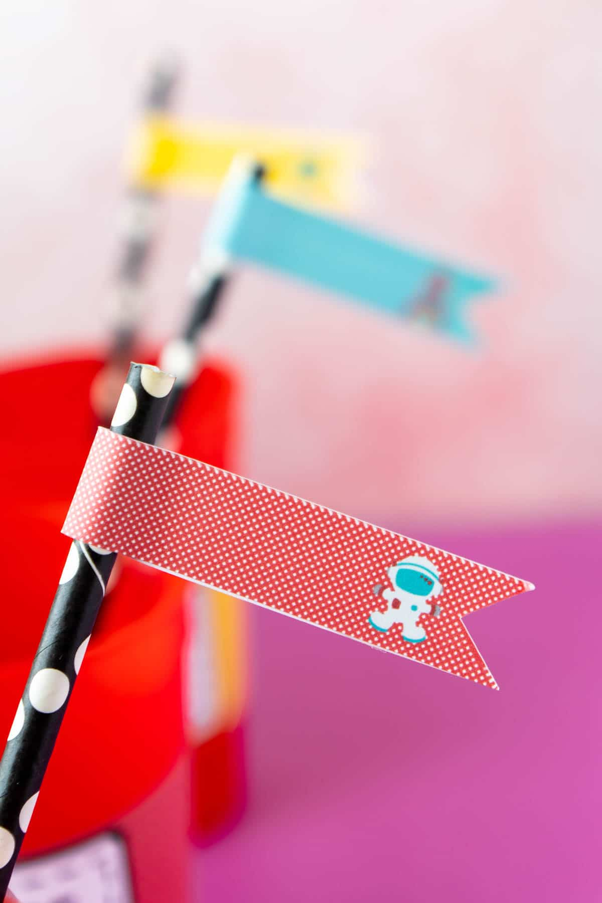 straw flags with outer space party decorations