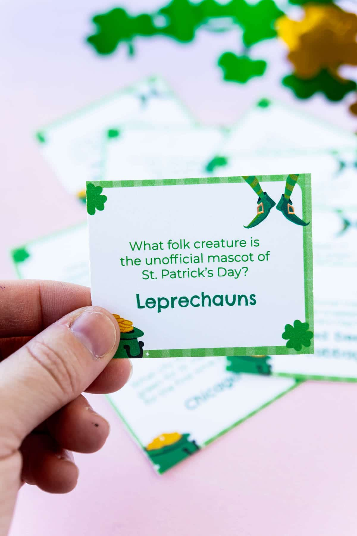 Hand holding a St. Patrick's Day trivia card