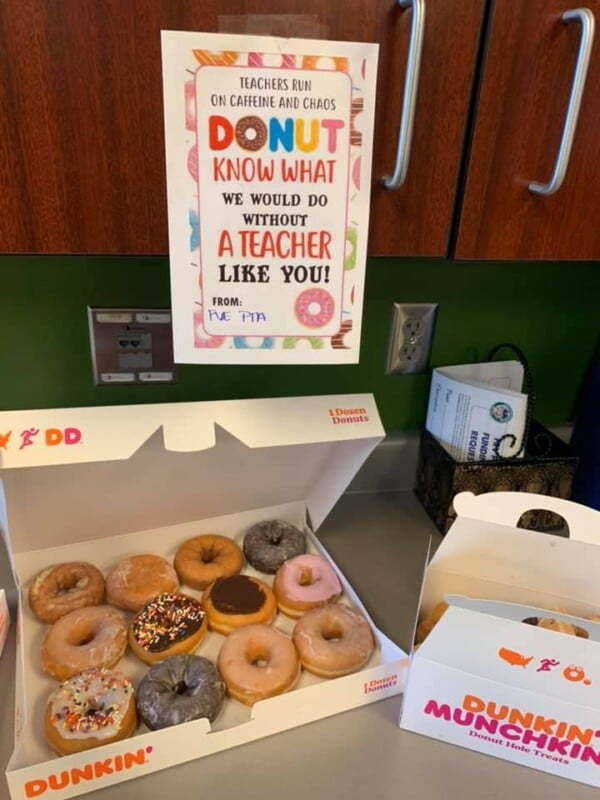Donuts with a sign hanging above them