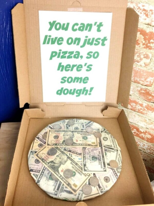 pizza box filled with cash