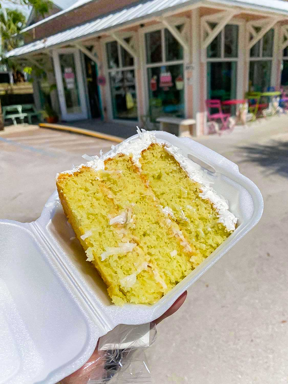 piece of coconut key lime cake in a styrofoam box