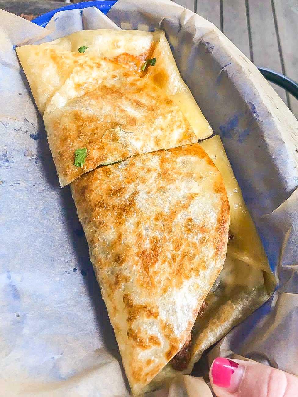Chicken quesadilla cut in half