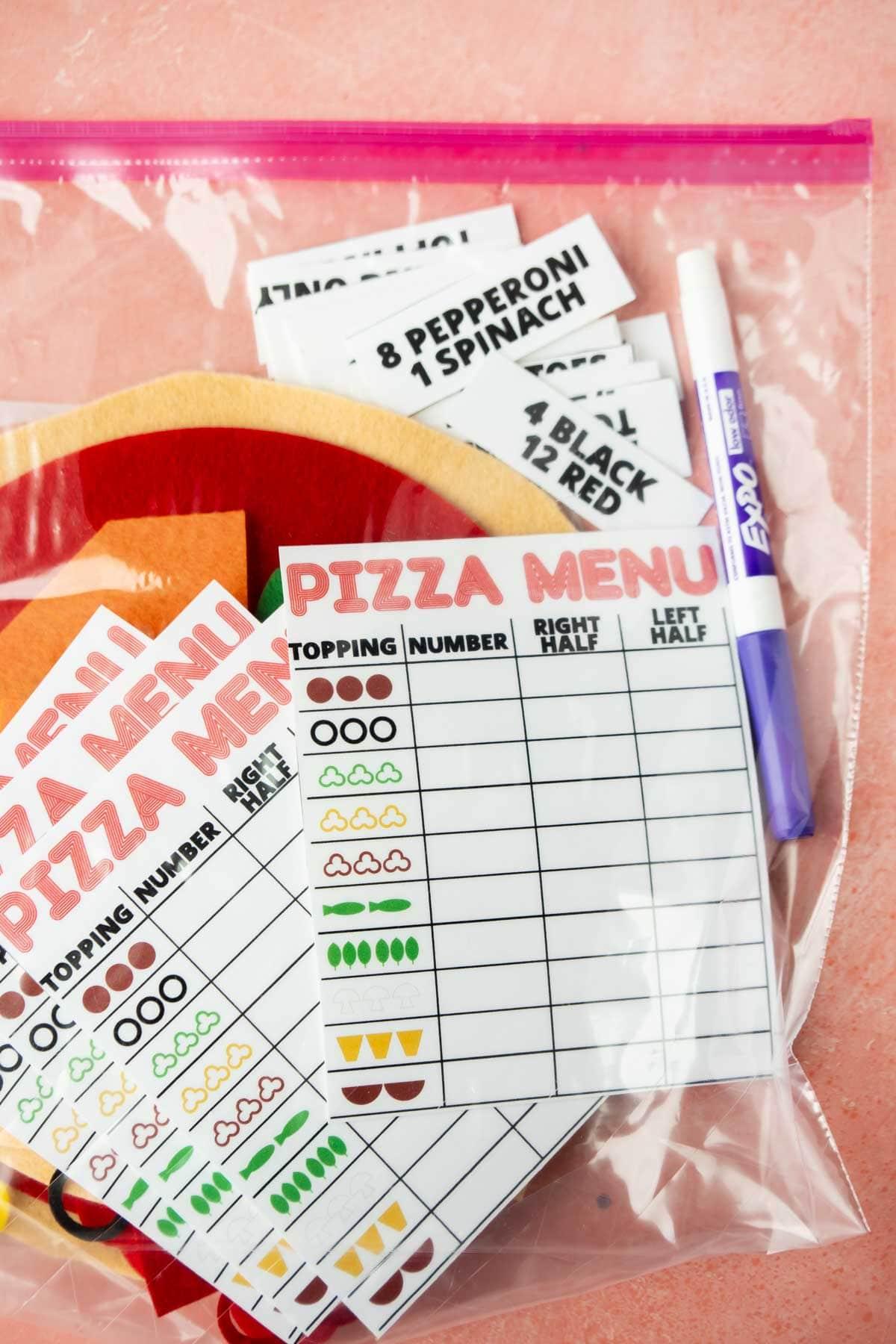felt pizza set and menu cards in a plastic bag