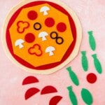 Felt pizza with toppings all around