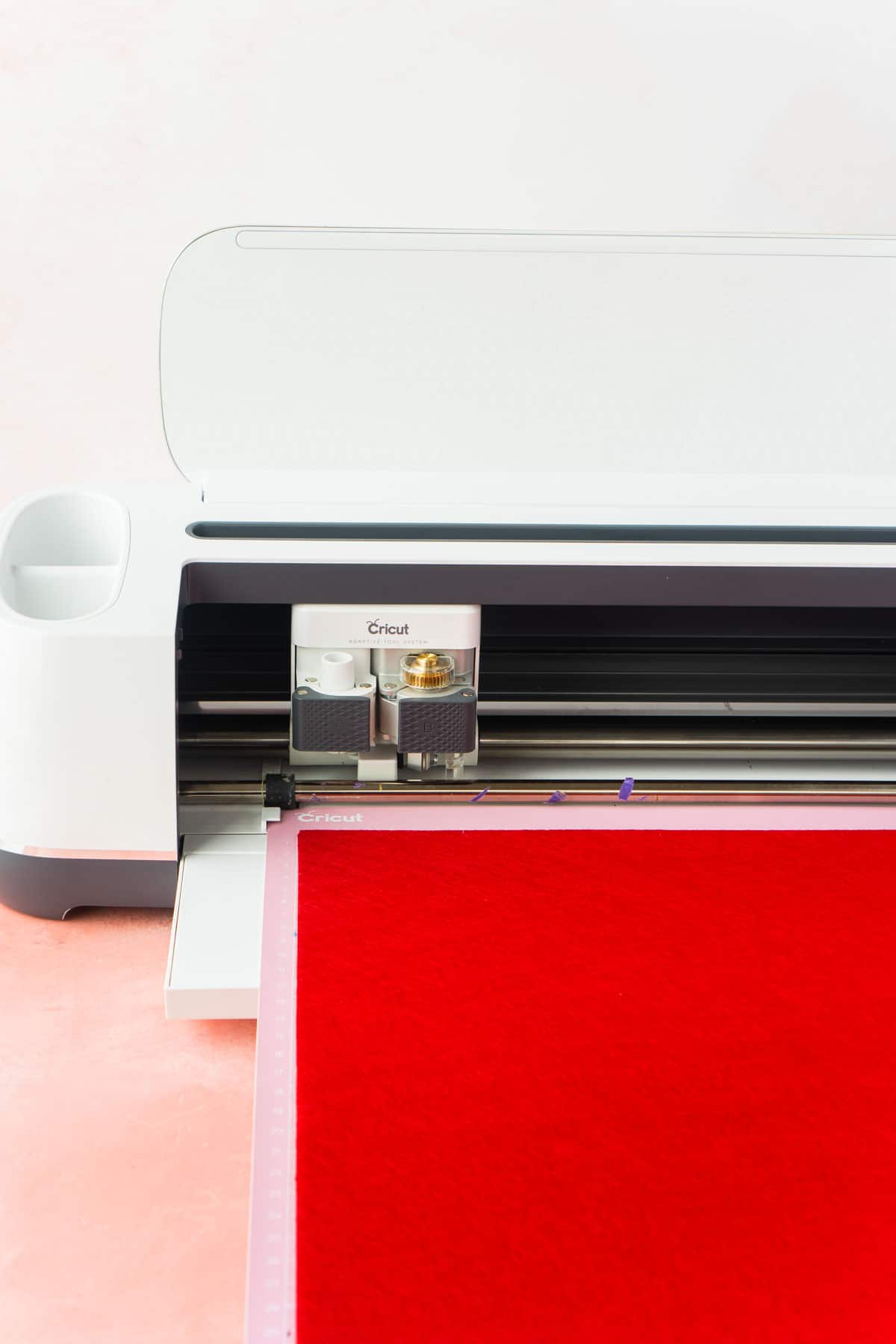 Cricut Maker with a piece of felt loaded onto the mat