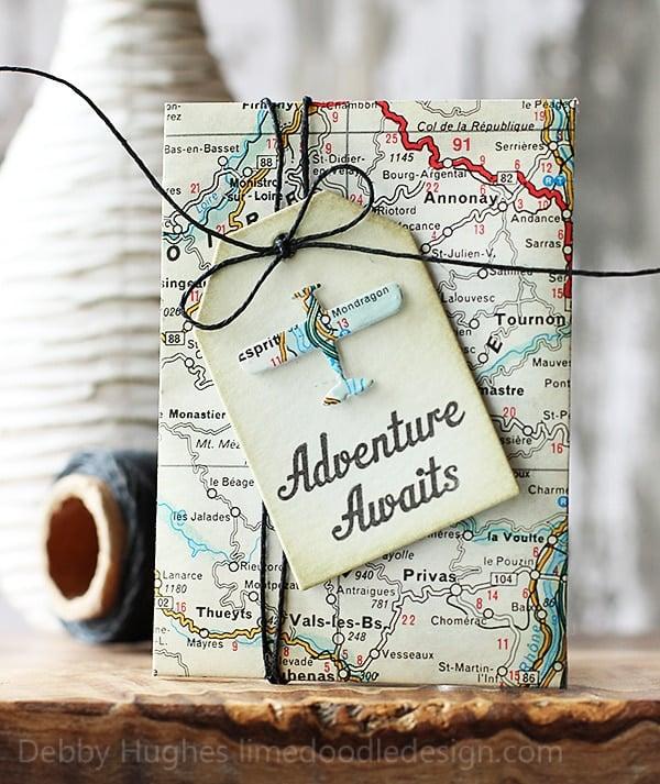 Adventure awaits tag on a journal
