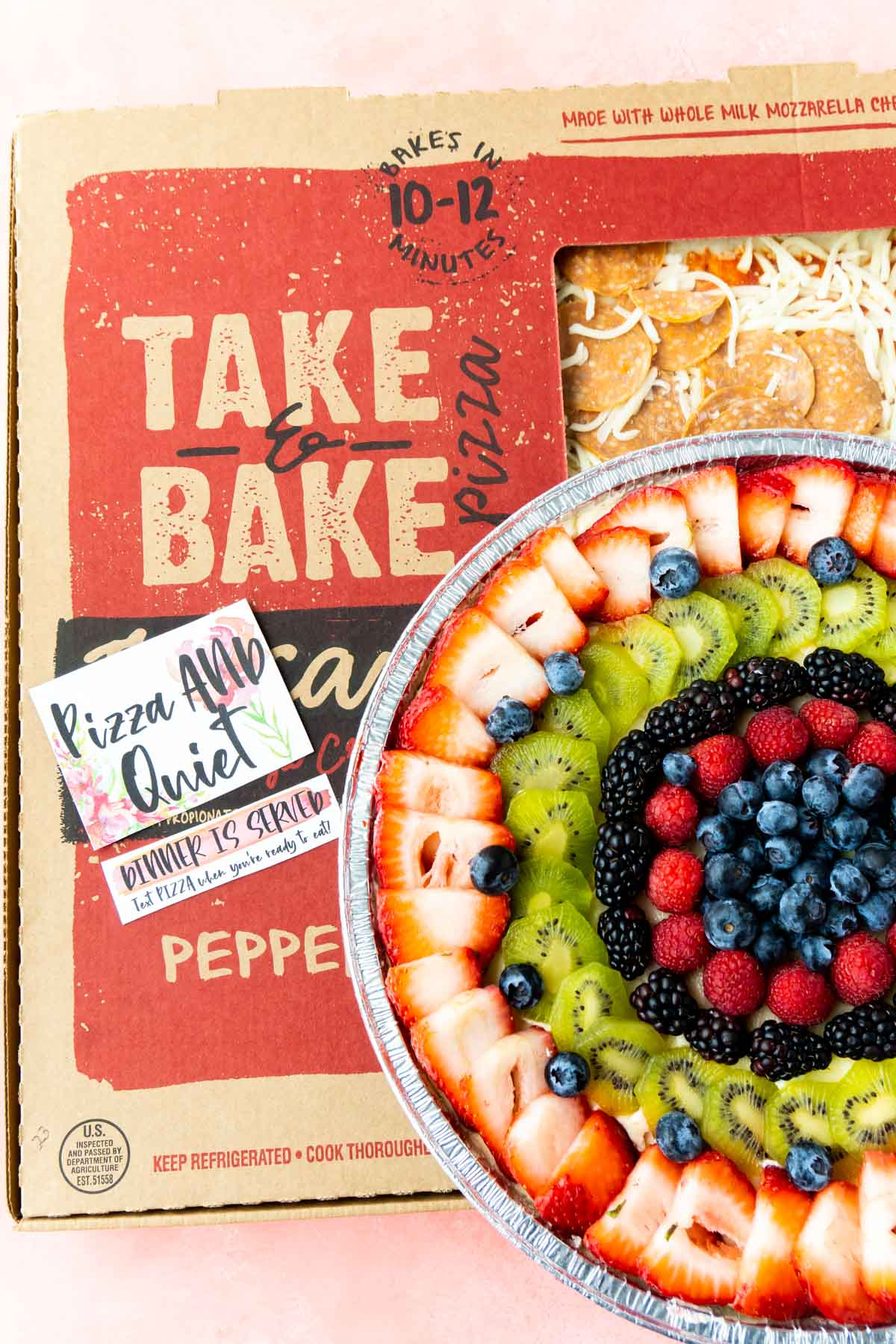 Pizza box with a fruit pizza on top