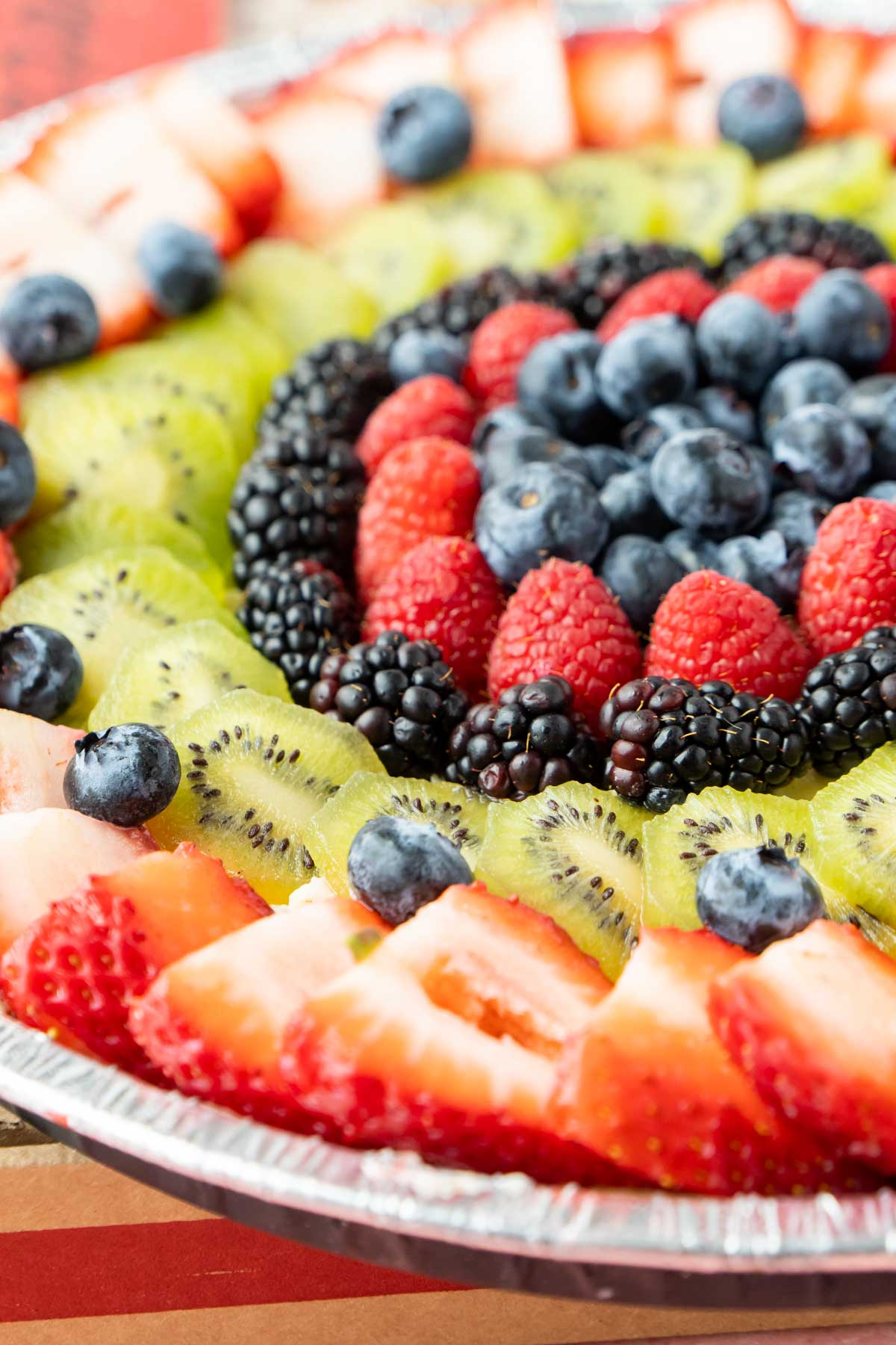 Fruit pizza with strawberries, blueberries, and kiwi