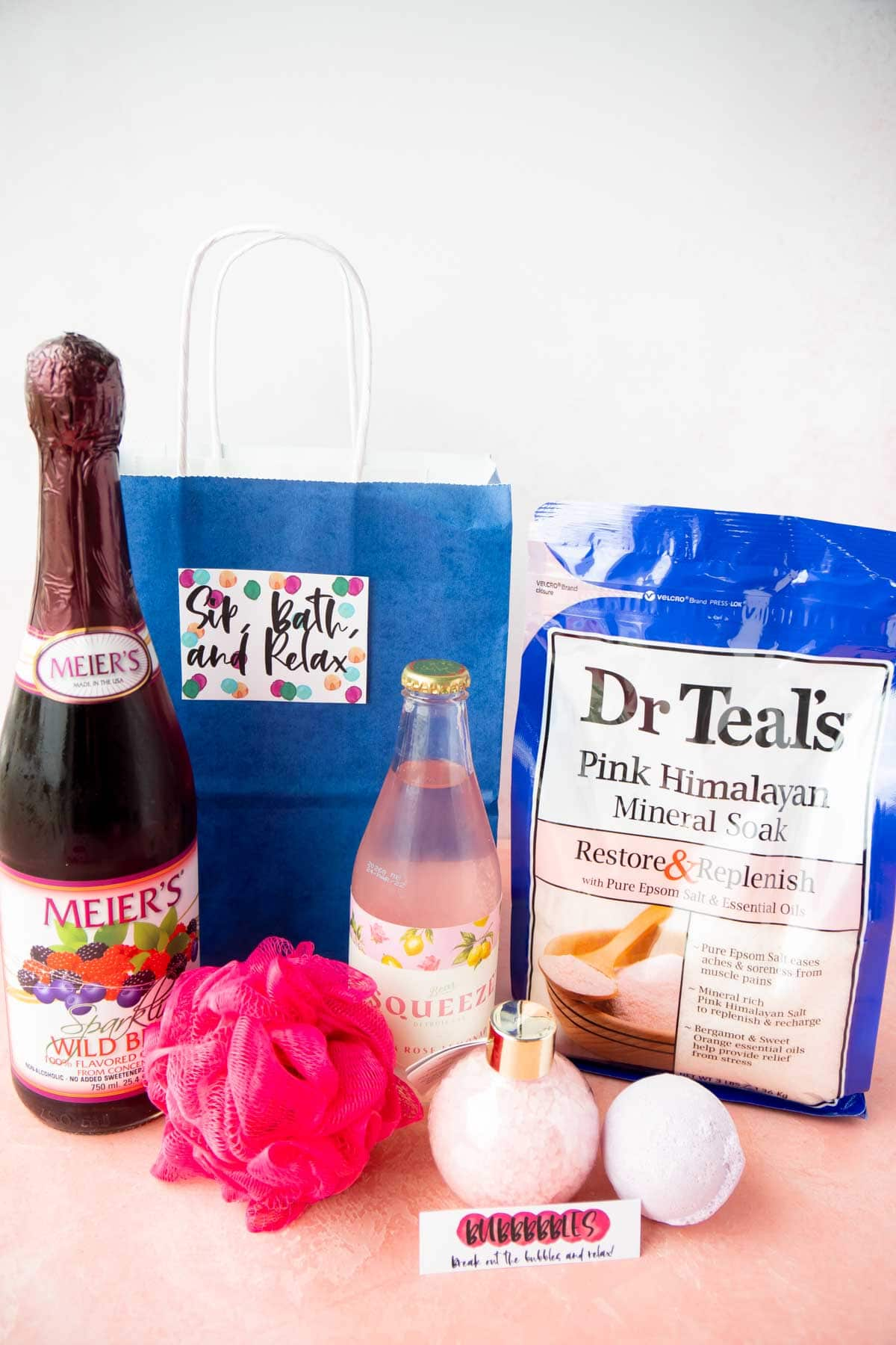 Blue gift basket with sparkling cider and bath salts