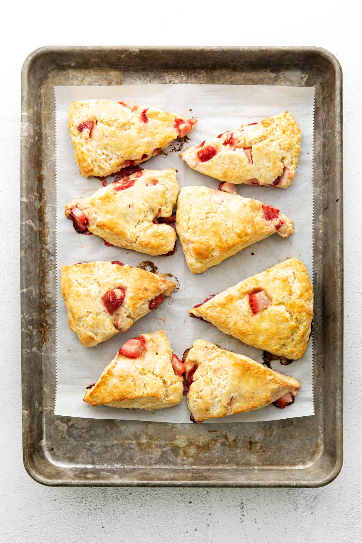 baked strawberry scones on a cookie sheet