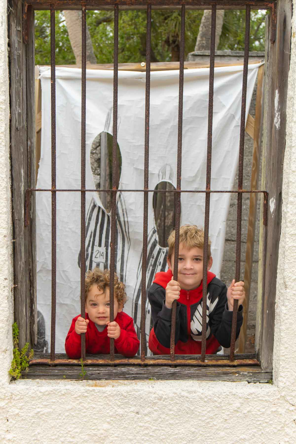 two boys behind bars