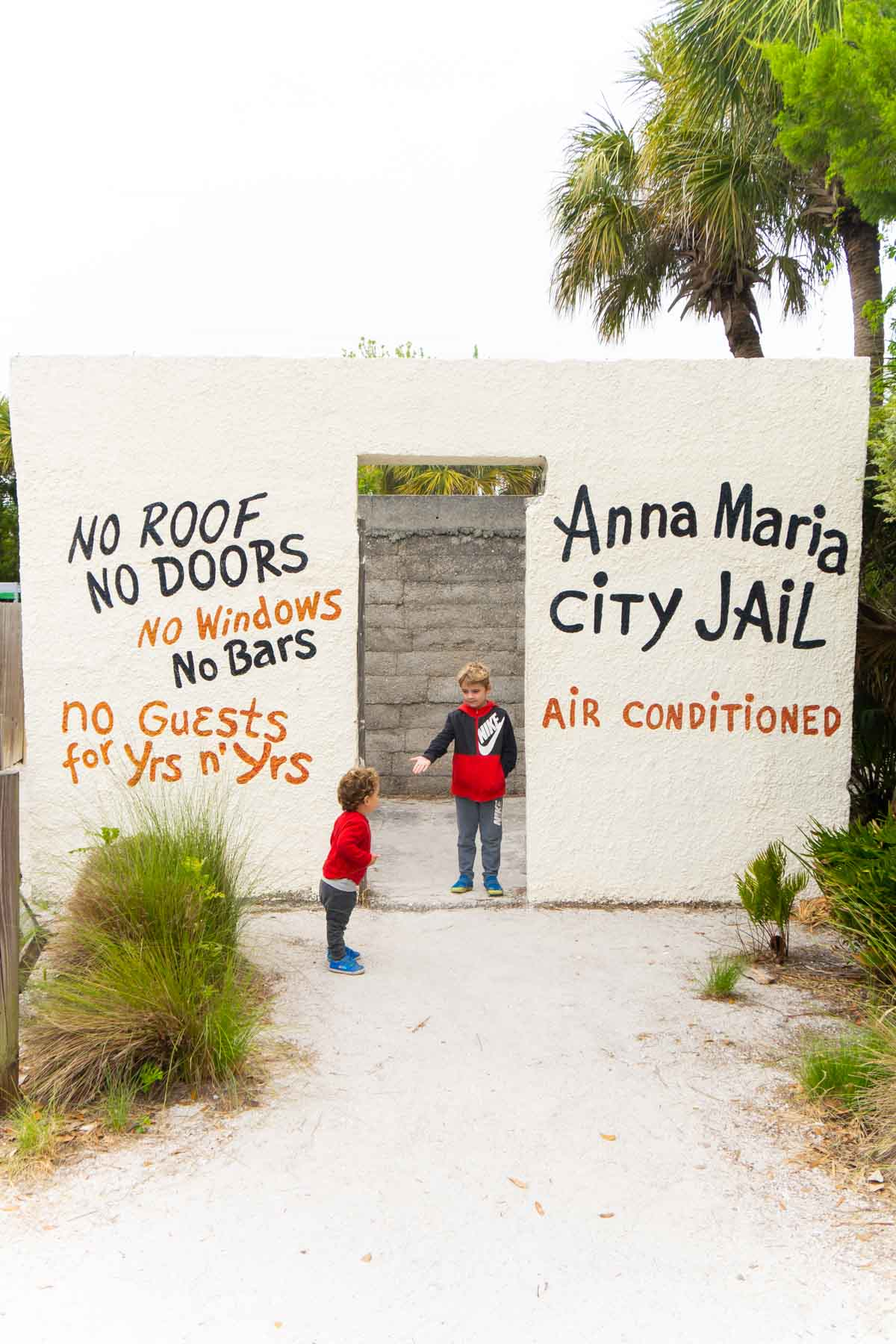 Two boys by Anna Maria city jail