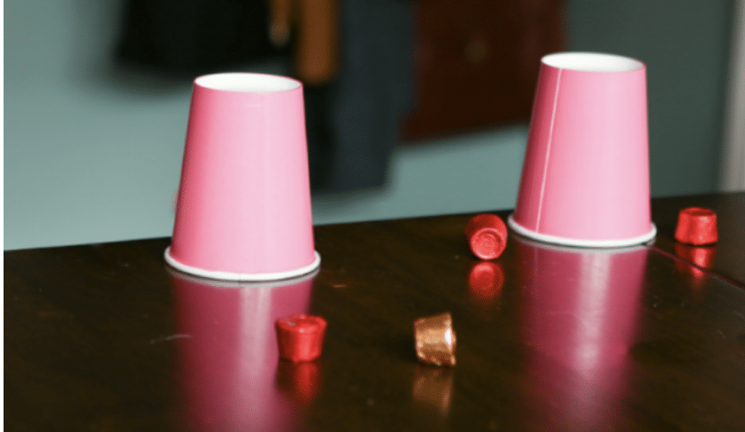 pink paper cups at the end of a table