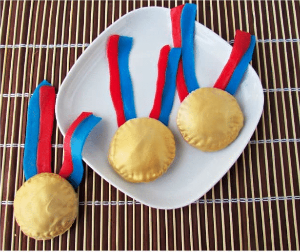 White plate with edible gold medals on top