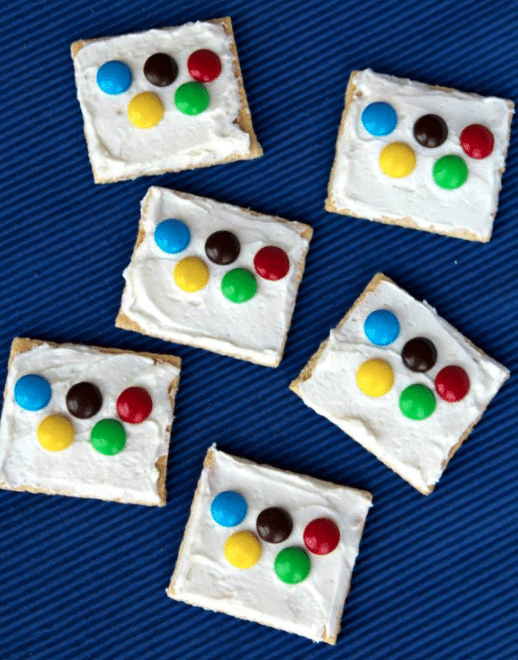 Graham crackers covered with frosting and M&Ms